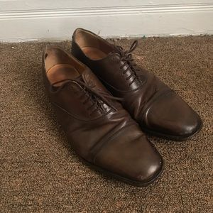Brown Gucci dress shoes w/ monogram heel size 8.5